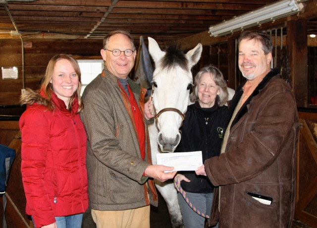 Jen Wassan, development director, Bob Gore, Boxford resident and Board President, Mandy Hogan, executive director and Dr. Peter McAllister, Boxford with Finn, the therapy horse.